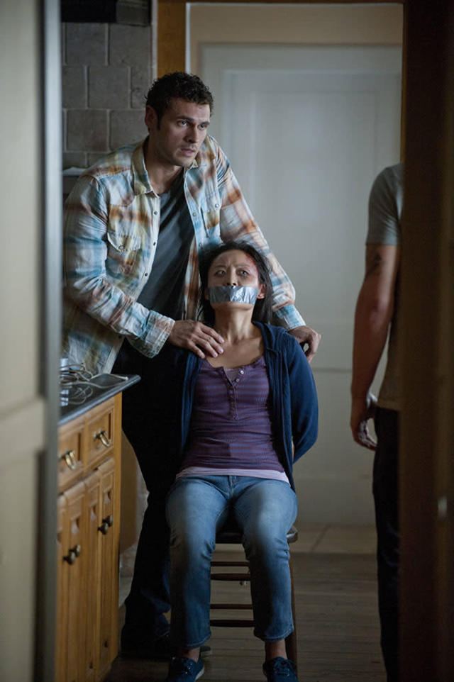 "Paul (Adan Canto) kidnaps a woman in the ""The Poet's Fire"" episode of ""The Following."""