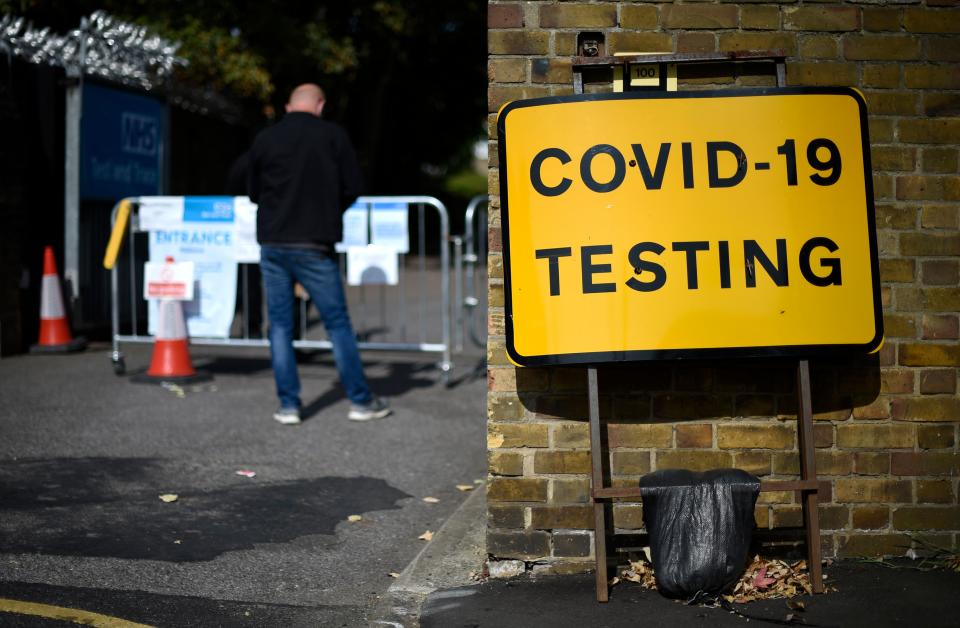 "A man wearing a face covering due to the COVID-19 pandemic, queues to attend a novel coronavirus walk-in testing centre in East Ham in east London, on September 17, 2020. - British Prime Minister Boris Johnson said Thursday he could close pubs earlier to ""stop the second hump"" of coronavirus cases, comparing the country's trajectory of resurgent transmission to a camel's profile. But the prime minister has faced stinging criticism this week over the failure to achieve the ""world-beating"" testing and tracing system he promised by the summer. (Photo by DANIEL LEAL-OLIVAS / AFP) (Photo by DANIEL LEAL-OLIVAS/AFP via Getty Images)"