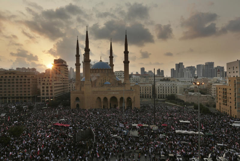 Anti-government protesters shout slogans during a protest in Beirut, Lebanon, Sunday, Oct. 20, 2019. Tens of thousands of Lebanese protesters of all ages gathered Sunday in major cities and towns nationwide, with each hour bringing hundreds more people to the streets for the largest anti-government protests yet in four days of demonstrations.  (AP Photo/Hassan Ammar)