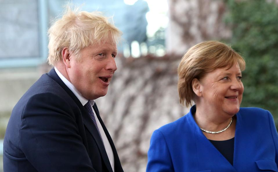 BERLIN, GERMANY - JANUARY 19: German Chancellor Angela Merkel (CDU, R) greets British Prime Minister Boris Johnson as he arrives for an international summit on securing peace in Libya at the German federal Chancellery on January 19, 2020 in Berlin, Germany. Leaders of nations and organizations linked to the current conflict are meeting to discuss measures towards reaching a consensus between the warring sides and ending hostilities. (Photo by Adam Berry/Getty Images)