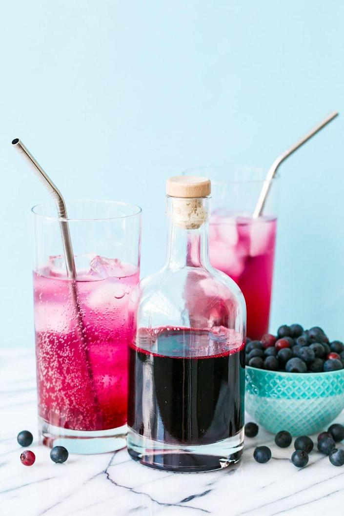 """<p>Mix this tart and tangy homemade syrup with club soda or ginger beer for a vividly-colored non-alcoholic summer drink. </p><p>Get the <a href=""""https://www.loveandoliveoil.com/2016/07/blueberry-soda-syrup.html"""" rel=""""nofollow noopener"""" target=""""_blank"""" data-ylk=""""slk:recipe"""" class=""""link rapid-noclick-resp"""">recipe</a>.</p>"""
