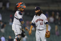 Houston Astros catcher Martin Maldonado and relief pitcher Ralph Garza Jr. (61) celebrate after the final out in the ninth inning of a baseball game against the Detroit Tigers in Detroit, Thursday, June 24, 2021. Houston won 12-3. (AP Photo/Paul Sancya)