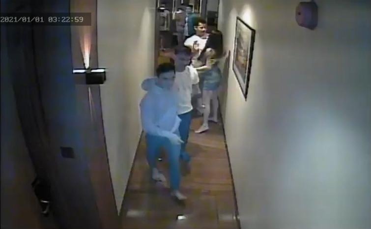 Christine Angelica Dacera, 23, is seen in a hallway at City Garden Hotel in Makati, Philippines, with some men.