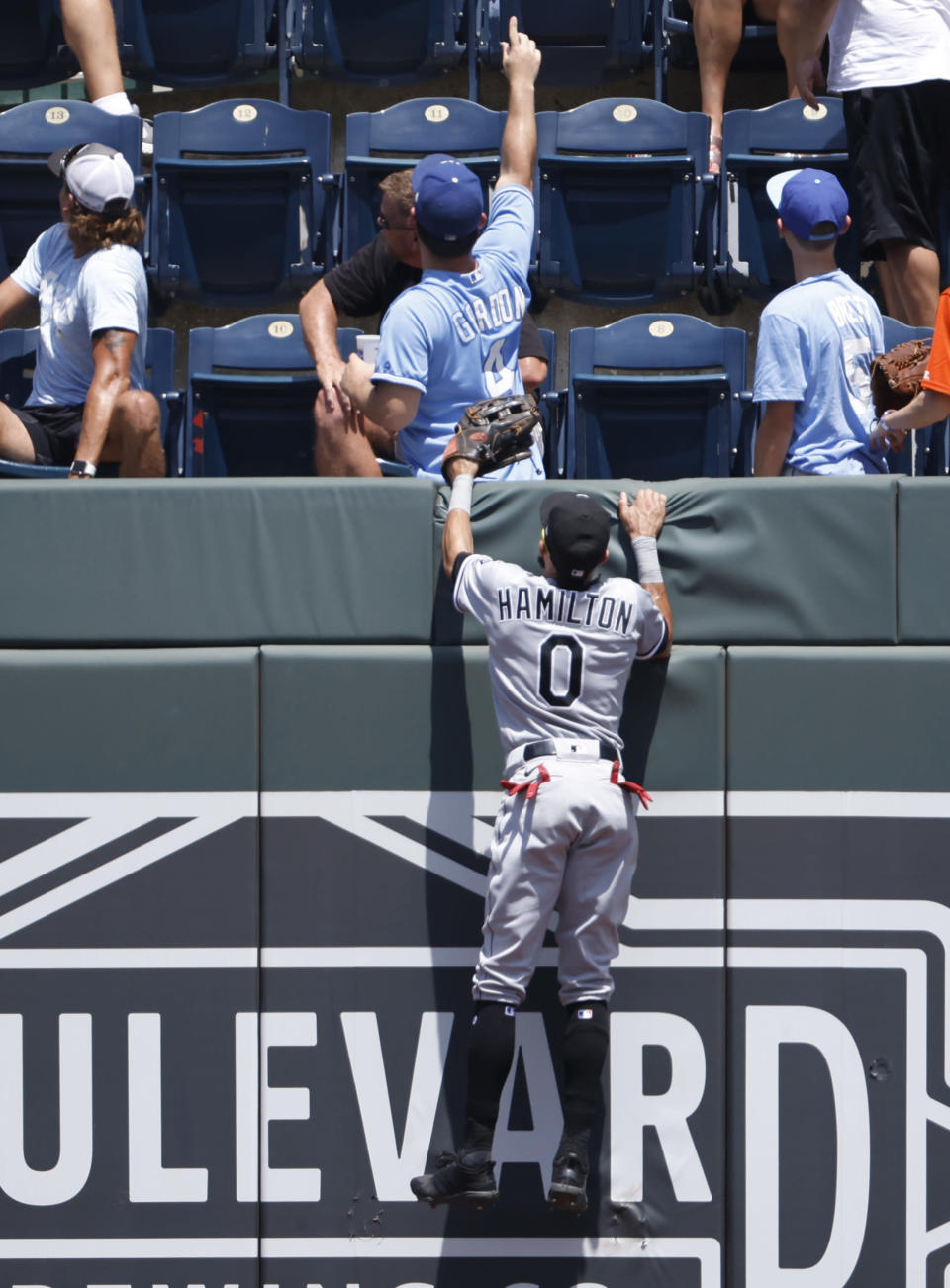 Chicago White Sox center fielder Billy Hamilton (0) jumps on to the wall to watch Kansas City Royals' Salvador Perez' two run home run during the first inning of a baseball game at Kauffman Stadium in Kansas City, Mo., Thursday, July 29, 2021. (AP Photo/Colin E. Braley)