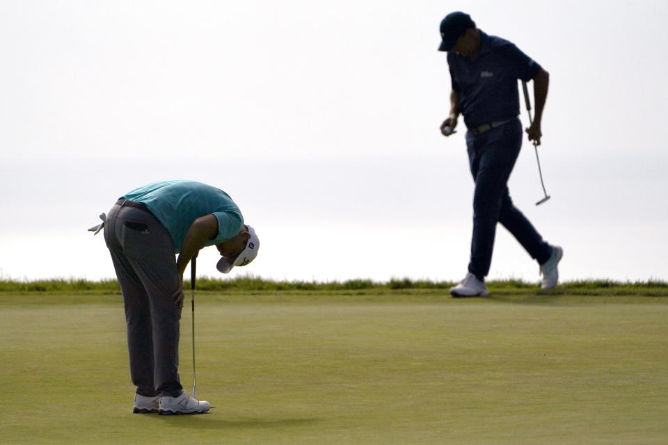Russell Henley, left, reacts after missing his putt on the 14th green as Richard Bland, of England, prepares to hit during the third round of the U.S. Open Golf Championship, Saturday, June 19, 2021, at Torrey Pines Golf Course in San Diego. (AP Photo/Jae C. Hong)