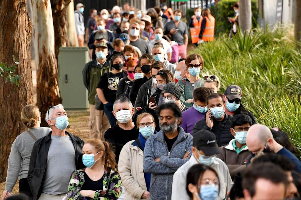 Sydneysiders queue outside a vaccination centre in Sydney.