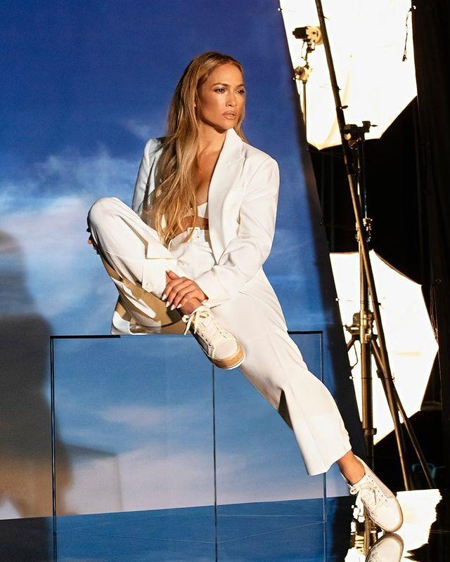 """<p>The 51-year-old star posed up a storm in a white suit and sneakers, but sans shirt, for her most recent shoot with DSW. Lopez wore her golden hair in long, loose waves for the campaign, giving us major mermaid vibes. </p><p>Is it only us, or would <a href=""""https://www.elle.com/uk/fashion/celebrity-style/a29510359/jennifer-lopez-wedding-dress-alex-rodriguez/"""" rel=""""nofollow noopener"""" target=""""_blank"""" data-ylk=""""slk:J-Lo look amazing in a white suit for her wedding to A-Rod"""" class=""""link rapid-noclick-resp"""">J-Lo look amazing in a white suit for her wedding to A-Rod</a>?</p><p><a class=""""link rapid-noclick-resp"""" href=""""https://www.elle.com/uk/fashion/what-to-wear/g29534510/wedding-suits-women/"""" rel=""""nofollow noopener"""" target=""""_blank"""" data-ylk=""""slk:SHOP WEDDING SUITS NOW"""">SHOP WEDDING SUITS NOW</a></p><p><a href=""""https://www.instagram.com/p/CMzxeSkJ01H/"""" rel=""""nofollow noopener"""" target=""""_blank"""" data-ylk=""""slk:See the original post on Instagram"""" class=""""link rapid-noclick-resp"""">See the original post on Instagram</a></p>"""