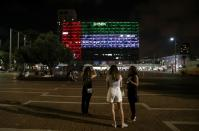 Tel Aviv's municipality building is lit in the Israeli and United Arab Emirates national flags following the announcement of a deal to normalise relations between the countries