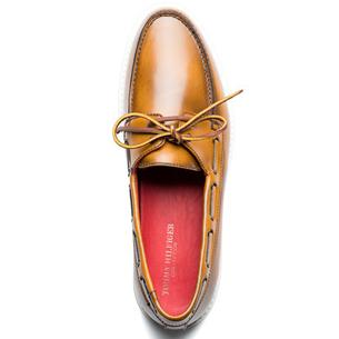Tommy Hilfiger- This polished cognac leather piece of footwear is made for going sockless. But on days when you feel like covering up down there, wear them in true Tommy style with a green or red pair of cotton trousers, combined with a casual summer knit and killer shades.