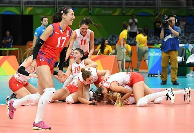 Serbia's players react after winning the women's semifinal volleyball match (Getty)