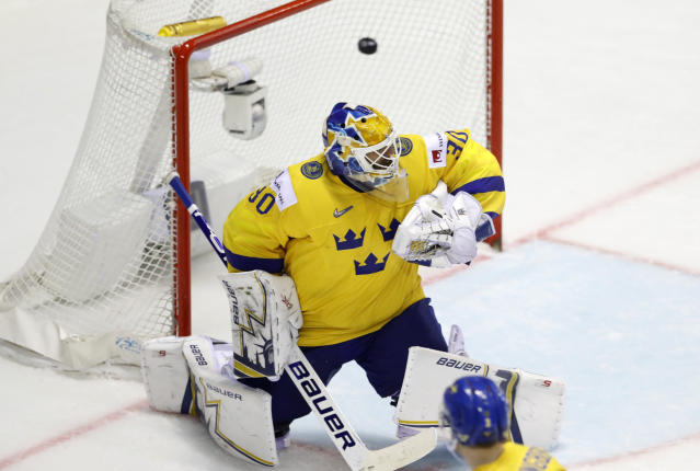 Sweden's goalkeeper Henrik Lundqvist fails to stop Finland's fifth goal during the Ice Hockey World Championships quarterfinal match between Finland and Sweden at the Steel Arena in Kosice, Slovakia, Thursday, May 23, 2019. (AP Photo/Petr David Josek)