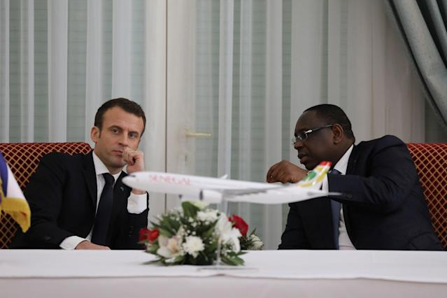 Senegalese President Macky Sall speaks with French President Emmanuel Macron during an agreement signing ceremony at the presidential palace in Dakar, Senegal, February 2, 2018. REUTERS/Ludovic Marin/Pool