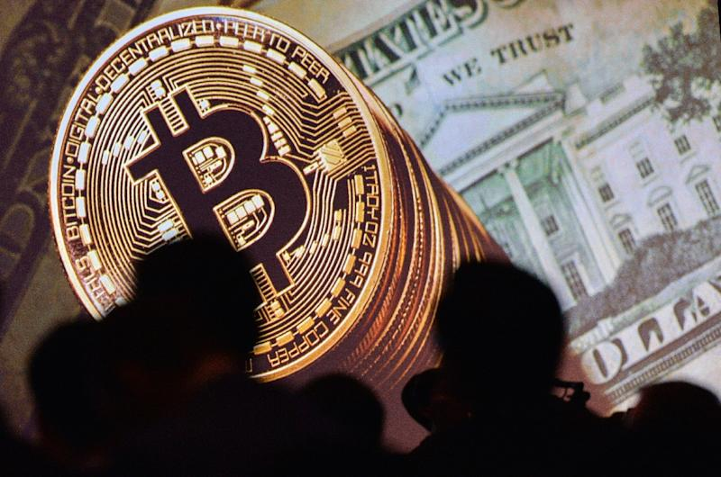 The international value of bitcoin and other cryptocurrencies has plunged amid Asia crackdown fears (AFP Photo/ROSLAN RAHMAN)