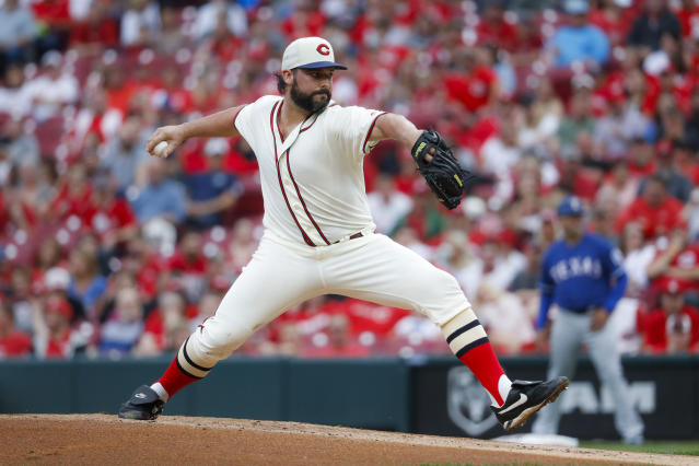 Cincinnati Reds starting pitcher Tanner Roark throws during the first inning of the team's baseball game against the Texas Rangers, Saturday, June 15, 2019, in Cincinnati. (AP Photo/John Minchillo)