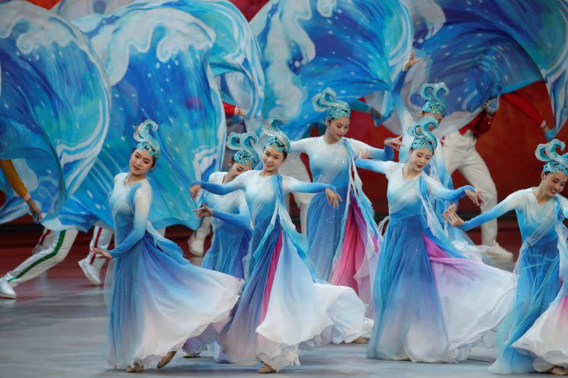 Performers take part in a cultural performance in Macau
