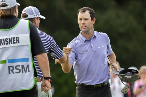 Robert Streb, right, fist-bumps Kevin Kisner after winning a second hole playoff at the RSM Classic golf tournament, Sunday, Nov. 22, 2020, in St. Simons Island, Ga. (AP Photo/Stephen B. Morton)