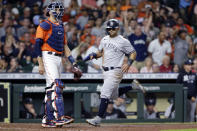 New York Yankees' Rougned Odor, right, scores next to Houston Astros catcher Jason Castro, left, on a single by Gio Urshela during the fourth inning of a baseball game Friday, July 9, 2021, in Houston. (AP Photo/Michael Wyke)
