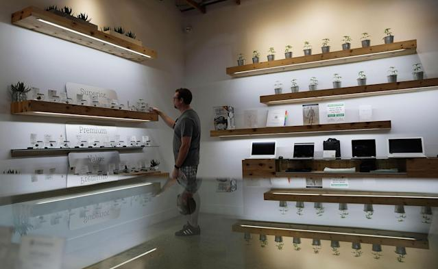 <p>A man shops for marijuana at The Source dispensary, Saturday, July 1, 2017, in Las Vegas. (Photo: John Locher/AP) </p>