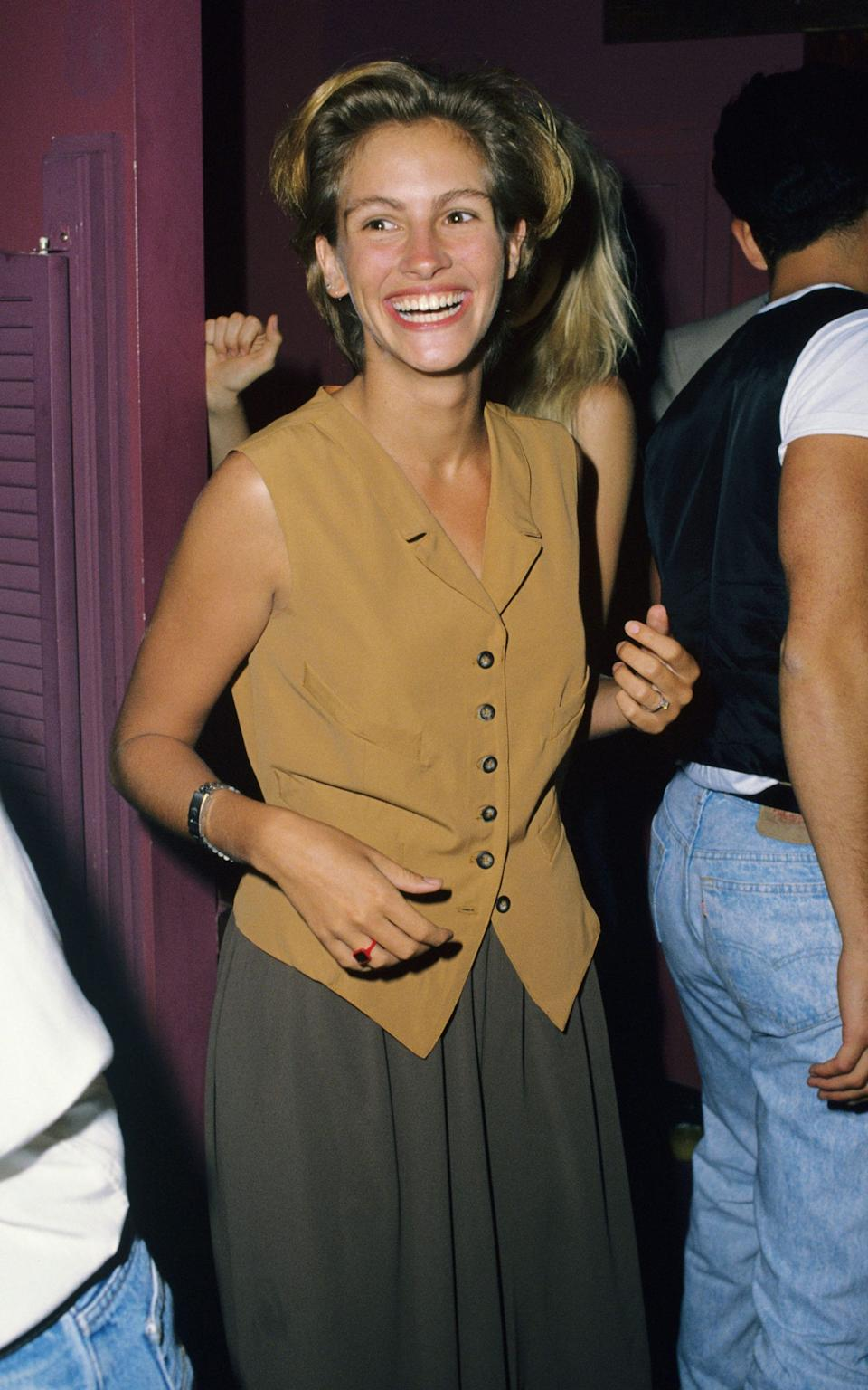 Julia Roberts in a waistcoat at theYoung Guns II Hollywood premiere - WireImage