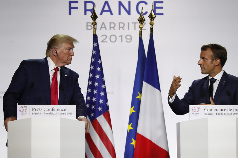 French President Emmanuel Macron, right, and U.S President Donald Trump attend the final press conference during the G7 summit Monday, Aug. 26, 2019 in Biarritz, southwestern France. (AP Photo/Francois Mori)