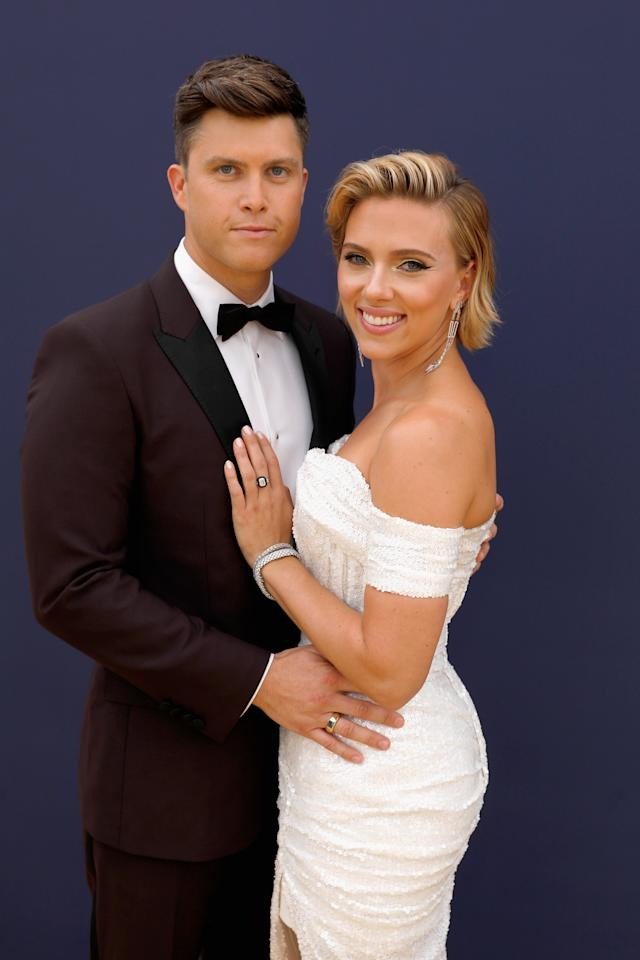 """<a href=""""https://www.glamour.com/about/scarlett-johansson?mbid=synd_yahoo_rss"""">Scarlett Johansson</a> and <em>SNL</em>'s Colin Jost got <a href=""""https://people.com/movies/scarlett-johansson-colin-jost-engaged/"""">engaged</a> in the spring. She showed off her massive, 11-carat diamond engagement ring, which <a href=""""https://pagesix.com/2019/07/22/scarlett-johansson-debuts-11-carat-engagement-ring-from-colin-jost/?utm_campaign=SocialFlow&utm_medium=SocialFlow&utm_source=P6Twitter&__twitter_impression=true%27"""">Page Six estimated</a> is worth around $400,000, during Comic-Con over the summer."""
