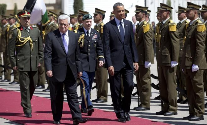 President Obama and Palestinian Authority President Mahmoud Abbas walk during an arrival ceremony on March 21 in Ramallah.