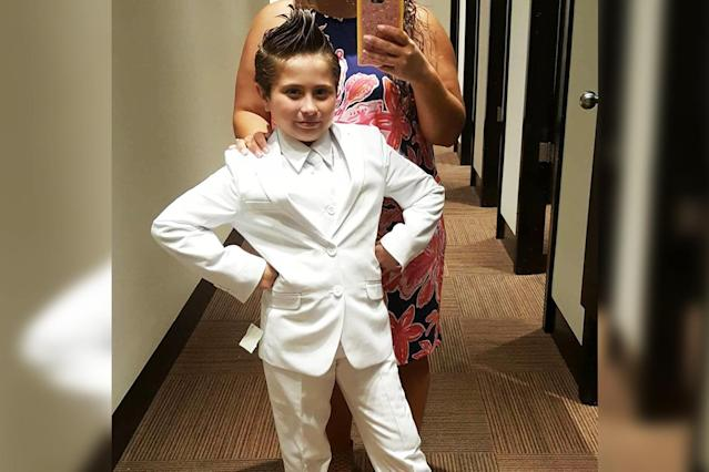 Cady, 9, rocking the white pantsuit she had hoped to wear to Communion. (Photo: Facebook/Chris Mansell)