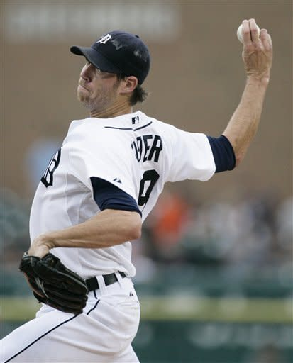 Detroit Tigers starter Doug Fister pitches against the Los Angeles Angels in the first inning of a baseball game Wednesday, July 18, 2012, in Detroit. (AP Photo/Duane Burleson)