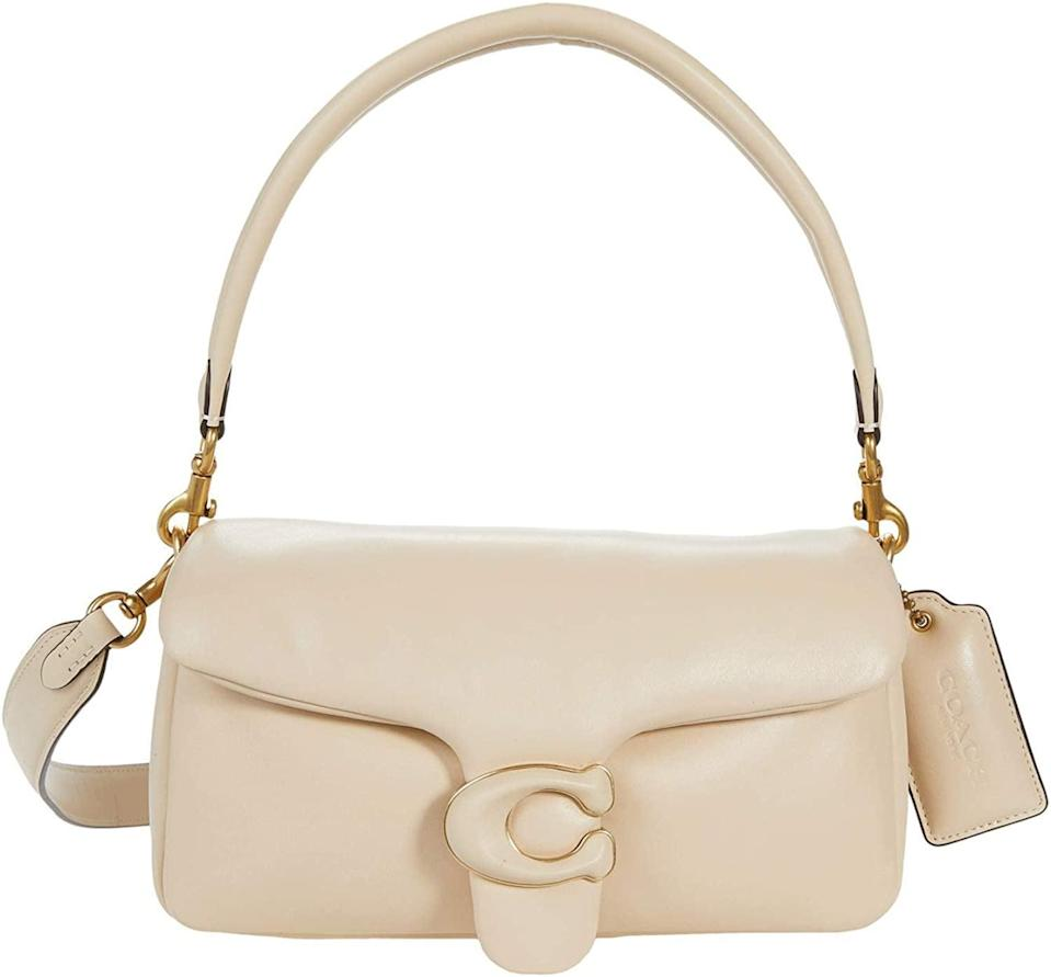 <p>The <span>Coach Leather Covered C Closure Puffy Tabby Shoulder Bag 26 B4/Ivory</span> ($495) is ultrachic and comes in black and a gorgeous blush pink.</p>