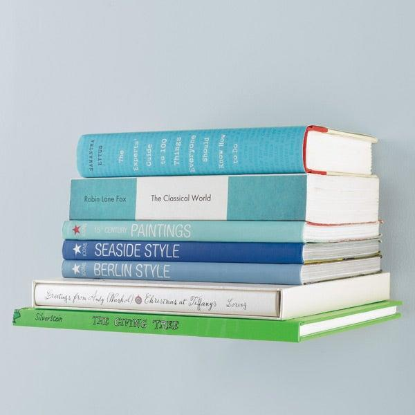 "<h2>Umbra Conceal Book Shelf</h2> <br>""As my book collection continues to grow, it seems like the space in my apartment shrinks. This floating shelf does more than offer a nifty solution for maximizing unused wall space for anyone in tight living quarters — it adds a pretty cool decorative touch to your home, too."" <em>– Amanda Randone, Market Writer</em><br><br><em>Shop <strong><a href=""https://www.containerstore.com/s?source=form&refinements=&q=umbra&submit="" rel=""nofollow noopener"" target=""_blank"" data-ylk=""slk:Umbra"" class=""link rapid-noclick-resp"">Umbra</a></strong></em><br><br><strong>Umbra</strong> Conceal Book Shelf, $, available at <a href=""https://go.skimresources.com/?id=30283X879131&url=https%3A%2F%2Fwww.containerstore.com%2Fs%2Fumbra-conceal-book-shelf%2Fd%3FproductId%3D10016053"" rel=""nofollow noopener"" target=""_blank"" data-ylk=""slk:The Container Store"" class=""link rapid-noclick-resp"">The Container Store</a><br><br><br>"
