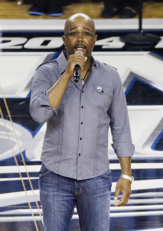 Country artist Darius Rucker the national anthem before the NCAA Final Four tournament college basketball championship game between Connecticut and Kentucky Monday, April 7, 2014, in Arlington, Texas. (AP Photo/Tony Gutierrez)