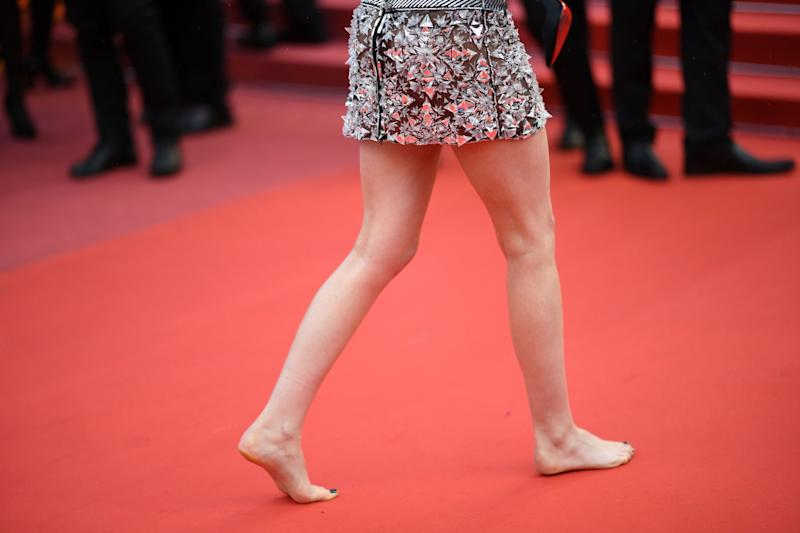 The 1 unspoken fashion rule women face at cannes each year us actress and member of the feature film jury kristen stewart walks barefoot on the red malvernweather Images