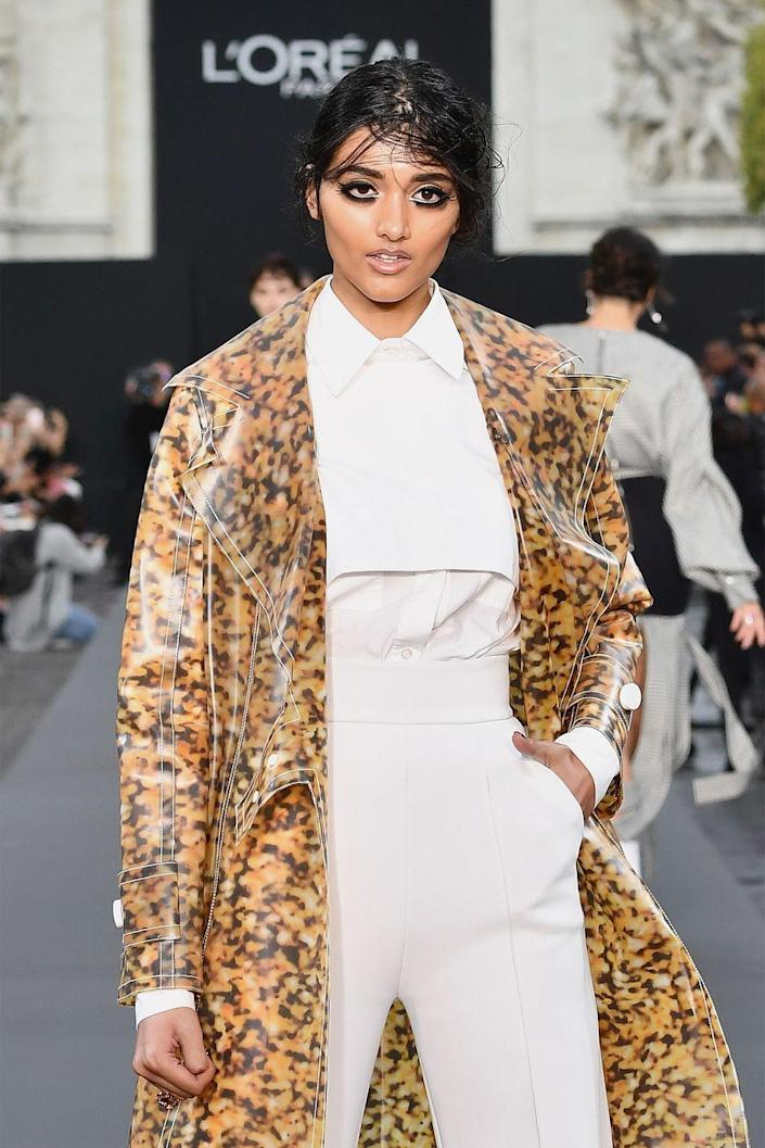 """<p>Although the London native was originally scouted for modeling when she still in high school, Gill officially broke through the industry when she landed a Burberry campaign at just 19 years old. It helped her popularity that this campaign was her first job ever, according to <a href=""""https://www.elle.com/fashion/news/a26940/neelam-gill-interview/"""" rel=""""nofollow noopener"""" target=""""_blank"""" data-ylk=""""slk:ELLE"""" class=""""link rapid-noclick-resp""""><em>ELLE</em></a>, and that she became the first Indian model to pose for the fashion house's ads.</p>"""