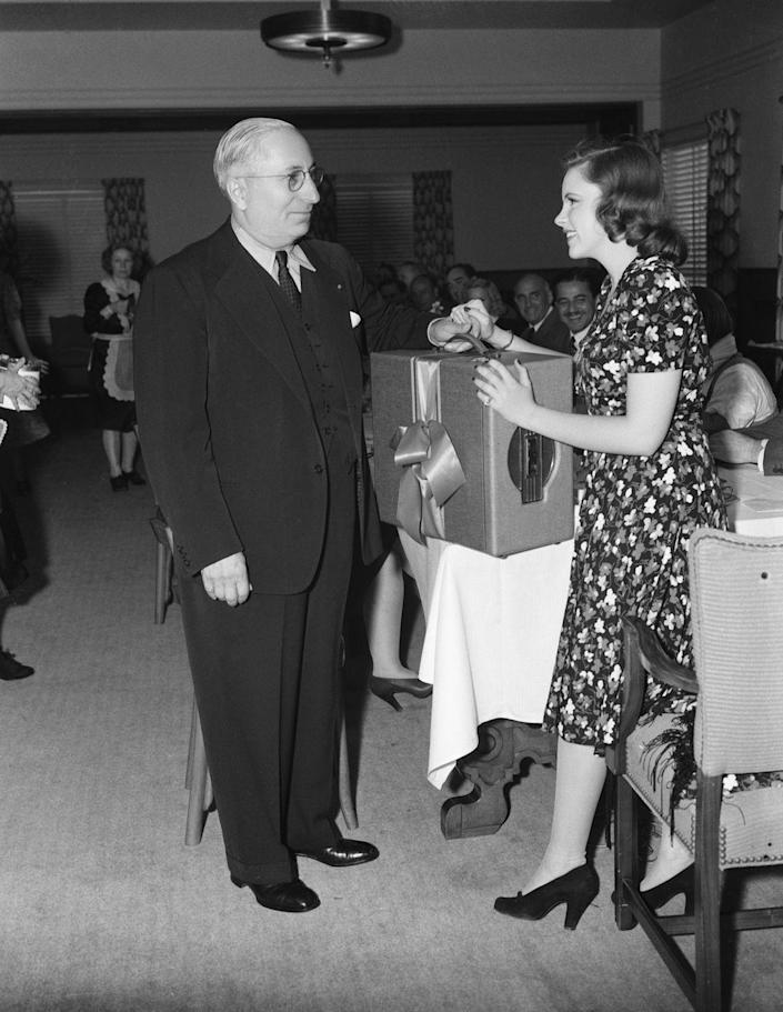 <p>Judy received a gift of a record player from studio head Louis B. Mayer at a luncheon celebrating her 18th birthday. </p>