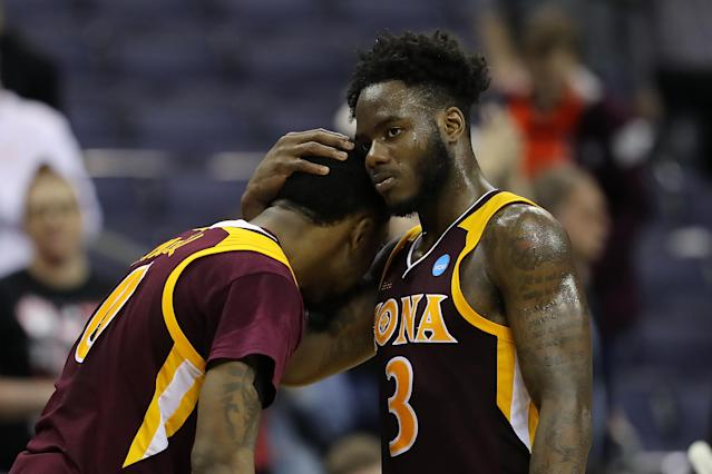 <p>Asante Gist #3 of the Iona Gaels embraces teammate Rickey McGill #0 after their 73-88 loss to the North Carolina Tar Heels in the first round of the 2019 NCAA Men's Basketball Tournament at Nationwide Arena on March 22, 2019 in Columbus, Ohio. </p>