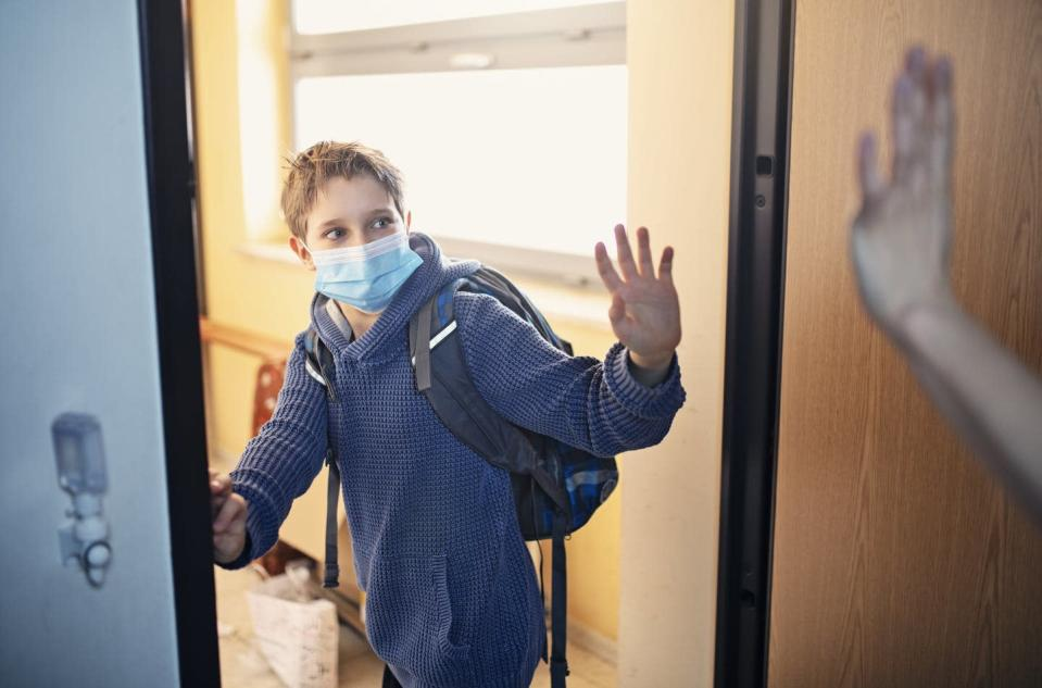 "<span class=""caption"">Whether just comfortable at home or nervous about leaving, kids may need extra support to get back out there.</span> <span class=""attribution""><a class=""link rapid-noclick-resp"" href=""https://www.gettyimages.com/detail/photo/little-boy-leaving-for-school-during-covid-19-royalty-free-image/1222730055"" rel=""nofollow noopener"" target=""_blank"" data-ylk=""slk:Imgorthand/E+ via Getty Images"">Imgorthand/E+ via Getty Images</a></span>"