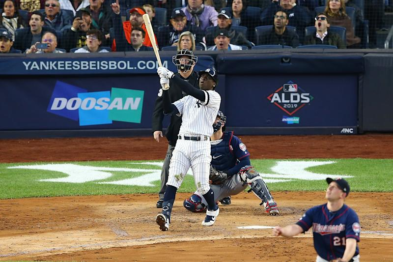 NEW YORK, NEW YORK - OCTOBER 05: Didi Gregorius #18 of the New York Yankees connects on a grand slam home run in the third inning against the Minnesota Twins during game two of the American League Division Series at Yankee Stadium on October 05, 2019 in New York City. (Photo by Mike Stobe/Getty Images)