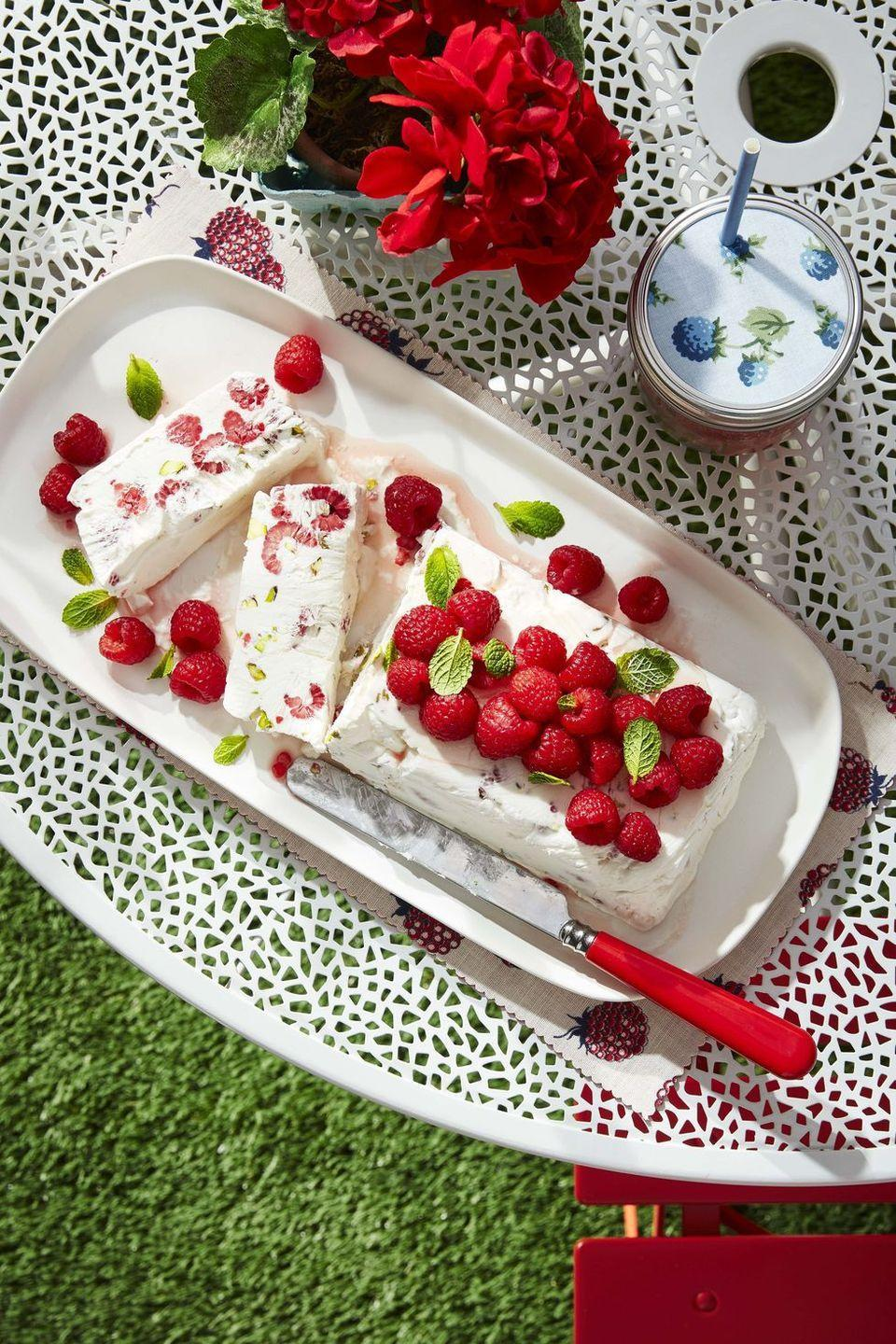 """<p>Meaning <em>semi-frozen</em>, this chilled dessert is chock-full of fresh raspberries and savory pistachios.</p><p><strong><a href=""""https://www.countryliving.com/food-drinks/a32352653/raspberry-and-pistachio-semifreddo/"""" rel=""""nofollow noopener"""" target=""""_blank"""" data-ylk=""""slk:Get the recipe"""" class=""""link rapid-noclick-resp"""">Get the recipe</a>.</strong> </p>"""