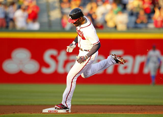 Atlanta Braves' Jason Heyward rounds second base after hitting a home run in the first inning of the baseball game against the New York Mets, Wednesday, April 9, 2014, in Atlanta. (AP Photo/Todd Kirkland)