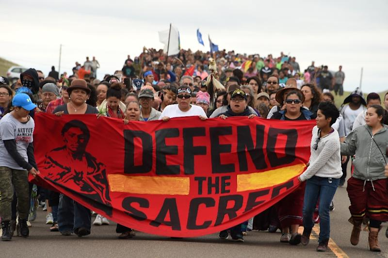 Native Americans march to the site of a sacred burial ground that was disturbed by bulldozers building the Dakota Access oil pipeline near Cannon Ball, North Dakota on September 4, 2016 (AFP Photo/Robyn Beck)