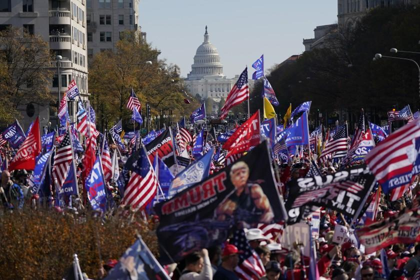With the U.S. Capitol in the background, supporters of President Donald Trump rally at Freedom Plaza, Saturday, Nov. 14, 2020, in Washington. (AP Photo/Julio Cortez)
