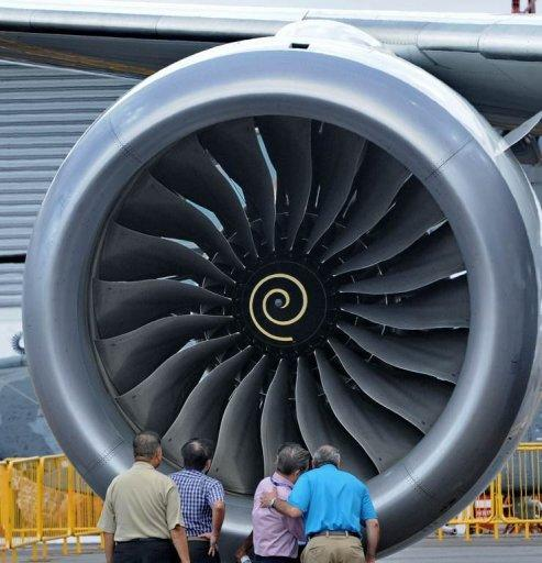 """Visitors are seen next to an engine of a Boeing 787 Dreamliner, displayed at the Singapore Airshow, on February 12. Boeing said around 55 of its flagship 787 Dreamliners """"have the potential"""" to develop a fuselage shimming problem, but reiterated that the fault was being fixed"""
