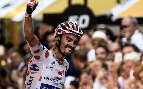Julian Alaphilippe pumps his fist in the air - Credit: afp