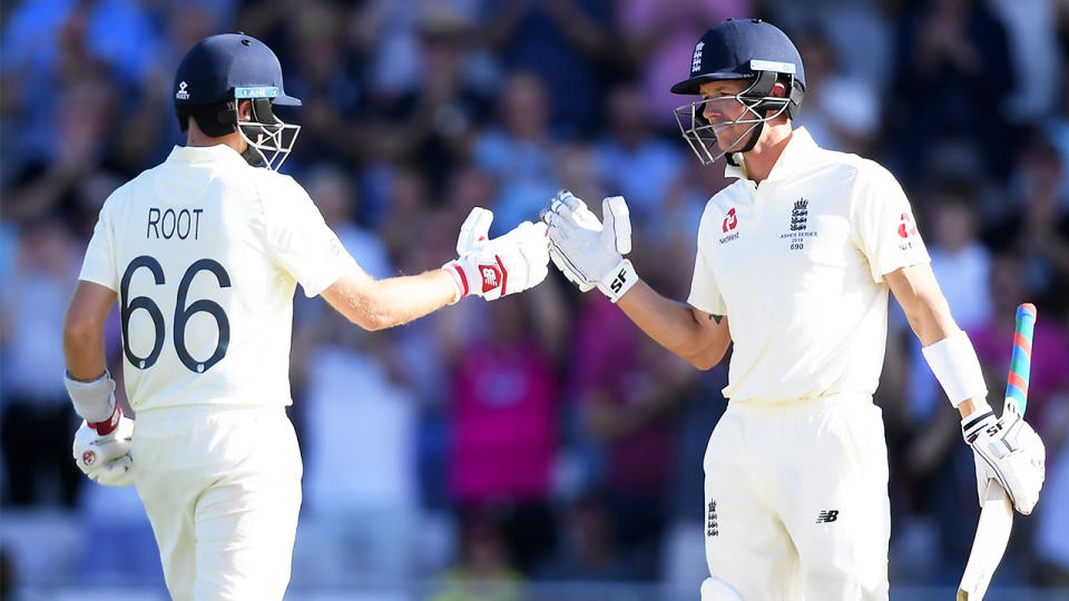 Joe Root and Joe Denly of England shake hands during Day Three of the 3rd Specsavers Ashes Test match between England and Australia at Headingley on August 24, 2019 in Leeds, England. (Photo by Alex Davidson/Getty Images)