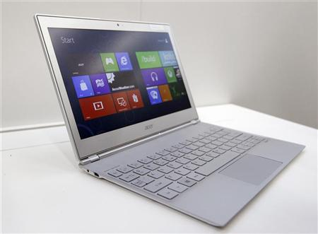 An Acer 11-inch ultrabook Aspire S7 with Microsoft Windows 8 operation system is displayed during a news conference as part of the preview of the 2012 Computex exhibition at the Taipei International Convention Center in Taipei