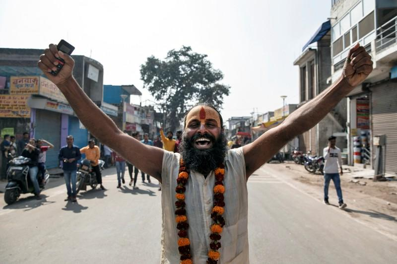 A Sadhu or a Hindu holy man celebrates after Supreme Court's verdict on a disputed religious site, in Ayodhya