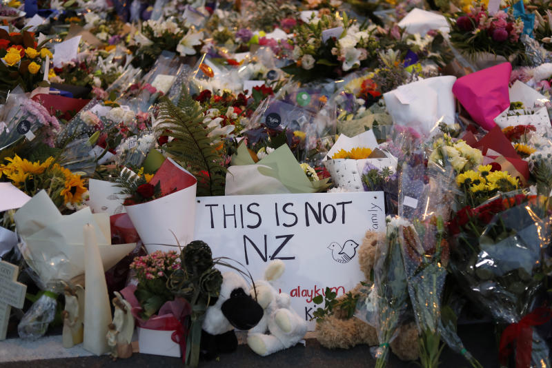 FILE - In this March 16, 2019, file photo, flowers lay at a memorial near the Masjid Al Noor mosque for victims in March 15 shooting in Christchurch, New Zealand. New Zealanders are debating the limits of free speech after their chief censor banned a 74-page manifesto written by a man accused of massacring 50 people at two mosques. (AP Photo/Vincent Yu, File)