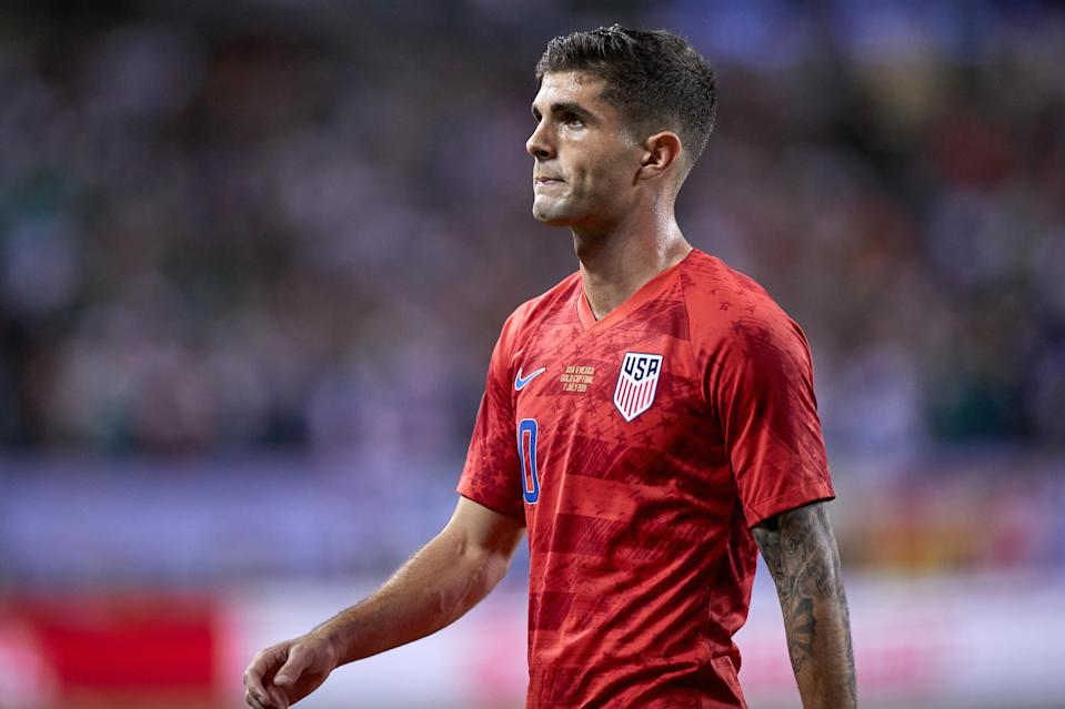 "<a class=""link rapid-noclick-resp"" href=""/soccer/players/613659/"" data-ylk=""slk:Christian Pulisic"">Christian Pulisic</a> and the United States could face a more challenging path to the 2022 World Cup if CONCACAF changes its qualifying format. (Robin Alam/Getty Images)"
