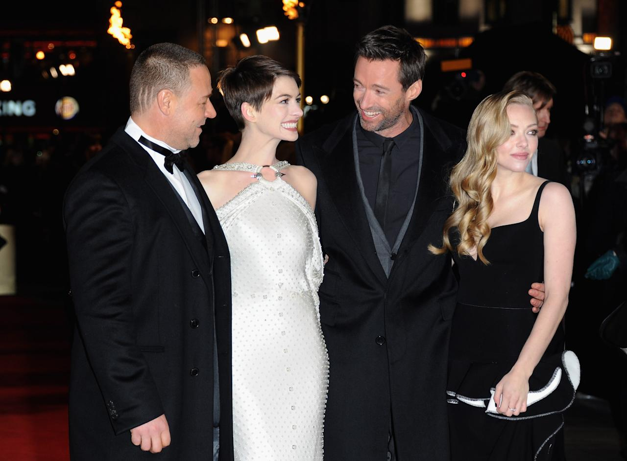 "LONDON, ENGLAND - DECEMBER 05:  Actors Russell Crowe, Anne Hathaway, Hugh Jackman and Amanda Seyfriend attend the ""Les Miserables"" World Premiere at the Odeon Leicester Square on December 5, 2012 in London, England.  (Photo by Stuart Wilson/Getty Images)"