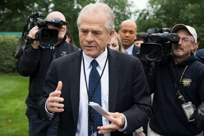 """(FILES) In this file photo taken on June 4, 2018 White House Director of Trade Policy Peter Navarro (C) dodges the press after speaking on Fox News at the White House in Washington, DC. A senior aide to US President Donald Trump apologized June 12, 2018 for saying there was a """"special place in hell"""" for Canadian Prime Minister Justin Trudeau, following the acrimonious Group of Seven summit.""""Let me correct a mistake I made,"""" White House economic advisor Peter Navarro was quoted as saying at a Washington event organized by The Wall Street Journal.""""I used language that was inappropriate,"""" he said, according to Journal reporters. """"I used language that was inappropriate,"""" he said, according to Journal reporters. / AFP PHOTO / JIM WATSONJIM WATSON/AFP/Getty Images ** OUTS - ELSENT, FPG, CM - OUTS * NM, PH, VA if sourced by CT, LA or MoD **"""